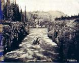 Boat navigating the Miles Canyon Rapids on the Yukon River, Yukon Territory, 1899.