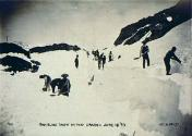 Clearing snow from the grade, probably at White Pass, for the White Pass and Yukon Railway, June...