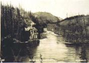 Entrance to Miles Canyon on the Yukon River, Yukon Territory, ca, 1899.