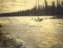 Boat navigating Whitehorse Rapids on the Yukon River, Yukon Territory, 1898