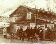 Mrs. Moulton and group of people outside the Moulton Hotel and store, Gold Bottom, Yukon...