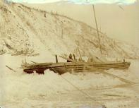 Scow arriving in Dawson after being caught in the freeze-up of the Yukon River, Yukon Territory,...