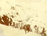 Klondikers approaching The Scales and preparing for ascent of Chilkoot Pass, Alaska, spring 1898.