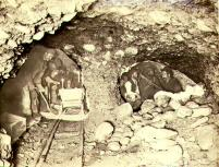 Miners working in underground gold mine by candlelight, Yukon Territory, ca. 1898.