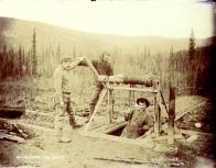 Simulation of gold mining accident, Yukon Territory, ca. 1899.