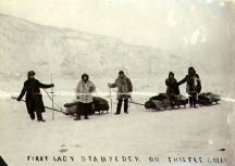 Woman and four men with sleds, Thistle Creek, Yukon Territory, ca. 1898.