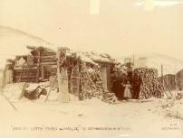 Baptisti Smith family outside of their log cabin, Yukon Territory, ca. 1898.
