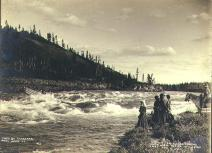 Captain J.W. Allard shooting the White Horse Rapids in a 15-foot skiff on the Yukon River, Yukon...