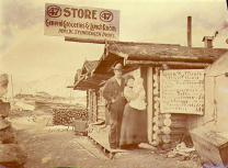 Mr. and Mrs. William Steinberger at their store and lunch house on Bonanza Creek, Yukon Territory,...