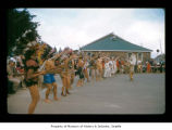 Men and boys dancing during an event at Makah Indian Reservation