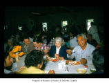 Joe Hilaire dining indoors with other people at Makah Indian Reservation