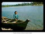 Cynthia Davis beside a canoe on the Quileute Indian Reservation
