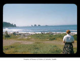 Woman looking toward sea stacks off the Washington coast, probably from First Beach on the...