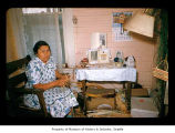 Agnes Penn in a house on the Quileute Indian Reservation