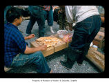 People eating baked salmon on the Quileute Indian Reservation