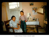 Agnes Penn with her grandson in a house on the Quileute Indian Reservation