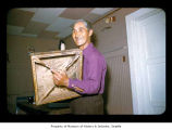 Tyler Hobucket holding a square drum, probably on the Quileute Indian Reservation