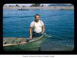 Steve Penn beside a canoe near or on the Quileute Indian Reservation