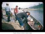 Men, women and fishing gear on the Quileute Indian Reservation