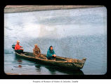 Harvey James, Walter Payne and Cynthia Davis in a canoe near or on the Quileute Indian Reservation