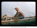 Walter Payne in a canoe near or on the Quileute Indian Reservation