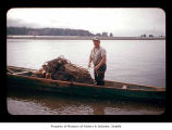 Baker Kowoosh in a canoe near or on the Quileute Indian Reservation