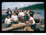 People eating near a river on the Quileute Indian Reservation
