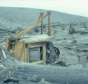 Logging crane destroyed in the crater by logs and shock wave