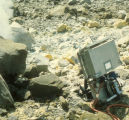 Backpack sampler next to high temperature vents with white volcanic deposits visible/present