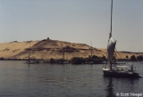 Felucca on the Nile near Elephantine; Qubbat al-Hawa (Muslim tomb) in background, atop hill of...