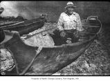 Charlie Howeattle sitting in a canoe, probably in Clallam County