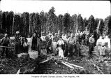 Hops pickers, including some Native Americans, standing near hops field in Forks