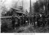 Ernie Wait's shingle mill and crew standing nearby, probably in Port Angeles