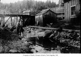 Makah women washing clothes in a creek at Neah Bay