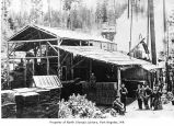 Ernie Wait's Shingle Mill with men posing outside in Port Angeles