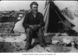 Native American man sitting on the beach in Port Townsend