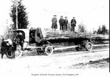 Duplex truck and crew hauling logs on Place Road, Port Angeles