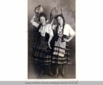 Two women, one named Mary Molloy, in costume with tambourines, n.d.