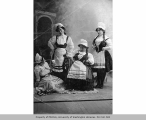 Four women in costume, n.d.