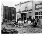 Horse and cart in front of the Northwestern Commercial Co. building, Nome, ca. 1905