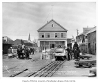 Freighting operations of the Alaska Mercantile Co. showing horse drawn wagon and tram car, Nome,...