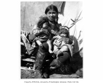 Eskimo woman and two infants, Nome beach, ca. 1905