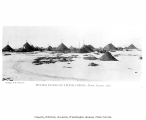 Winter mining dumps on Little Creek, near Nome, 1906