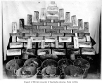 Gold bricks and buckets of gold ore belonging to the Miner's and Merchant's Bank, Nome, June 10,...