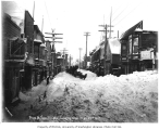 Front Street showing snow drifts, Nome, March 25, 1907
