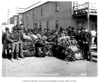Group of men with bundles of Siberian fur pelts, Nome, August 1906
