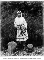 Eskimo woman with buckets of berries, ca. 1904