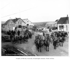Freight wagons, men and horses outside W.J. Rowe Transfer Co., Nome, October 26, 1907