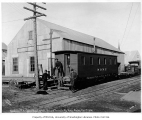 Seward Peninsula Railway car and warehouse, Nome, October 1, 1906