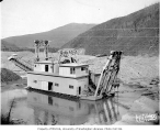Dredge YUKON NO. 3 during mining operation, probably Alaska, ca. 1905